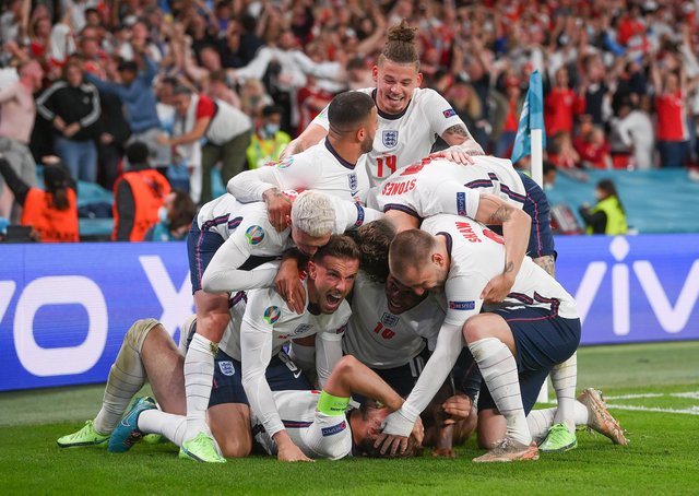 Harry Kane of England (obscured) celebrates with team mates after scoring the winning goal. (Photo by Laurence Griffiths/Getty Images)