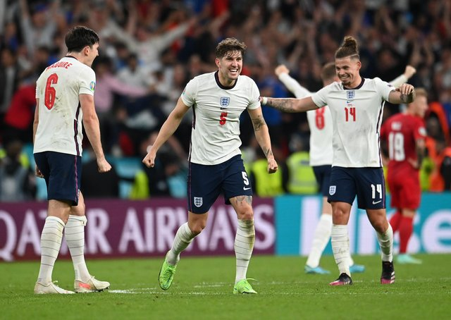 Harry Maguire, John Stones, and Kalvin Phillips of England celebrate following their team's victory in the UEFA Euro 2020 Championship Semi-final match between England and Denmark at Wembley Stadium (Picture: Andy Rain - Pool/Getty Images)