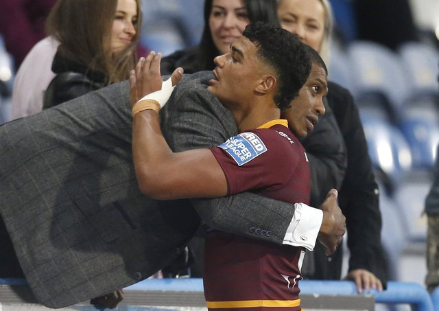 PROUD MOMENT: Huddersfield Giants' Will Pryce with his father, former player Leon Pryce, after his debut for Huddersfield Giants againtst Catalans Dragons. Picture by Ed Sykes/SWpix.com