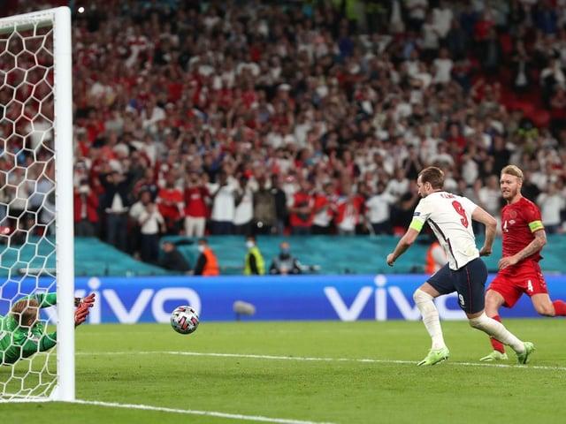 PENALTY: Kasper Schmeichel saves from Harry Kane in England's 2-1 win