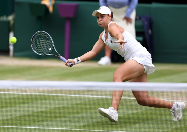 Tribute: Ashleigh Barty on her way to victory over Angelique Kerber in the semi-finals at Wimbledon. Barty is wearing a dress which is a nod to Australian great Evonne Goolagong Cawley. Picture: Steven Paston/PA Wire