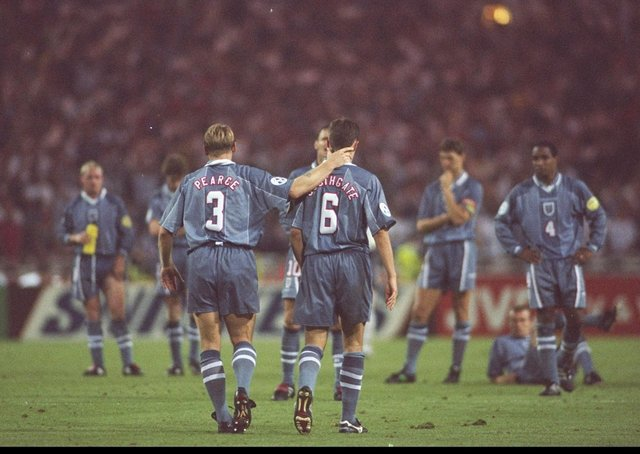 Stuart Pearce (left) consoles team-mate Gareth Southgate after his penalty miss during the Euro 96 semi-final (Picture: Ross Kinnaird/Allsport UK)