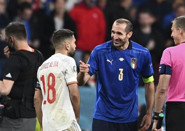 Italy's Giorgio Chiellini, 2nd left, talks to Spain's Jordi Alba, left, before the penalty shootout of the Euro 2020 semi-final. (Andy Rain/Pool via AP)