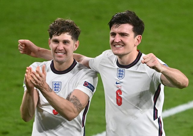 Harry Maguire and John Stones of England celebrate victory after the UEFA Euro 2020 Championship Semi-final match between England and Denmark. (Picture: Michael Regan - UEFA/UEFA via Getty Images)