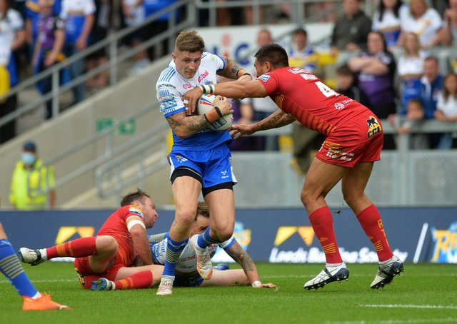 Leeds Rhinos' Liam Sutcliffe is tackled by Catalans' Dean Whare.  Picture: Jonathan Gawthorpe