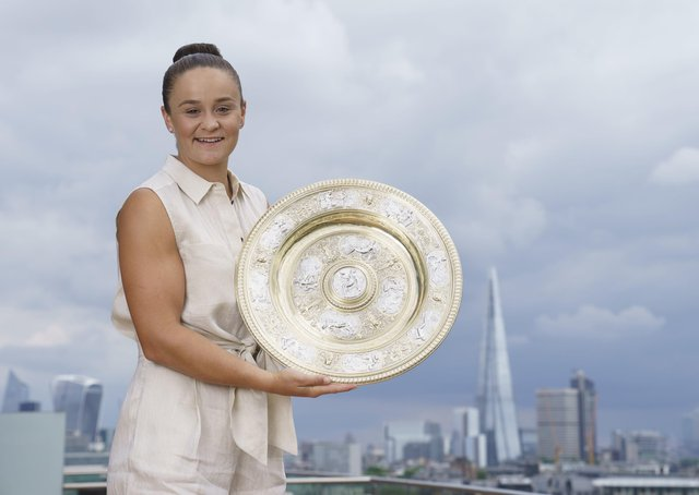Ash Barty: Poses with the Wimbledon trophy after winning the ladies singles title.