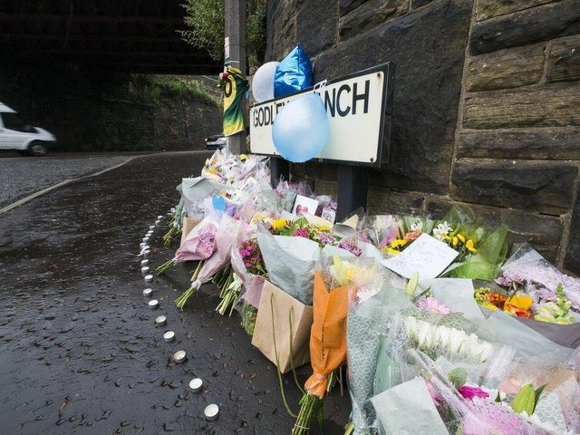 Floral tributes at the scene of the crash