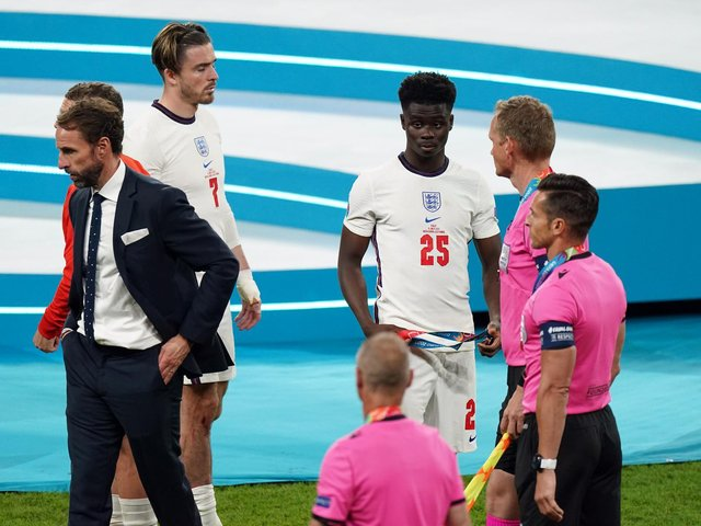 England's Bukayo Saka (25) alongside manager Gareth Southgate following the UEFA Euro 2020 Final