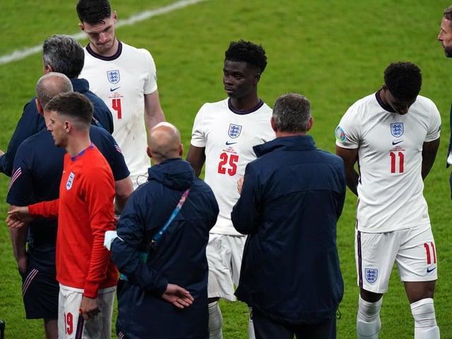 England manager Gareth Southgate stands dejected alongside Bukayo Saka and Jack Grealish following the UEFA Euro 2020 Final