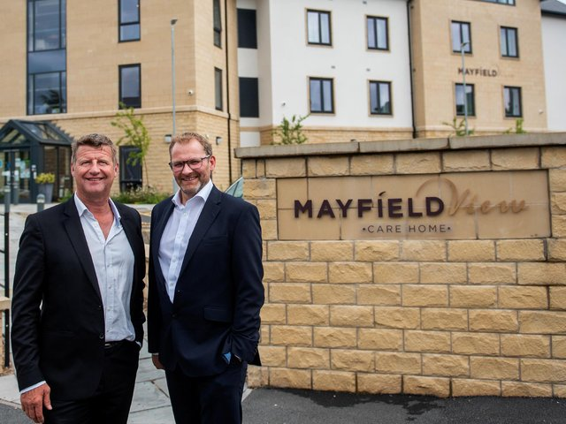 """(from left) Springfield Healthcare Group CEO Graeme Lee with James Nightingale, a Partner at Ward Hadaway, outside Mayfield View care home in Ilkley."""""""