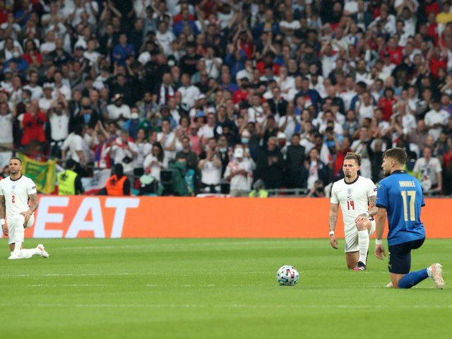 England's Kyle Walker (left) and Kalvin Phillips with Italy's Ciro Immobile takes the knee before the UEFA Euro 2020 Final at Wembley Stadium, London. Picture: Nick Potts/PA Wire