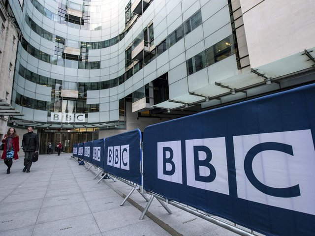 People walk past Broadcasting House, the headquarters of the BBC, on March 25, 2014 (Photo by Oli Scarff/Getty Images)
