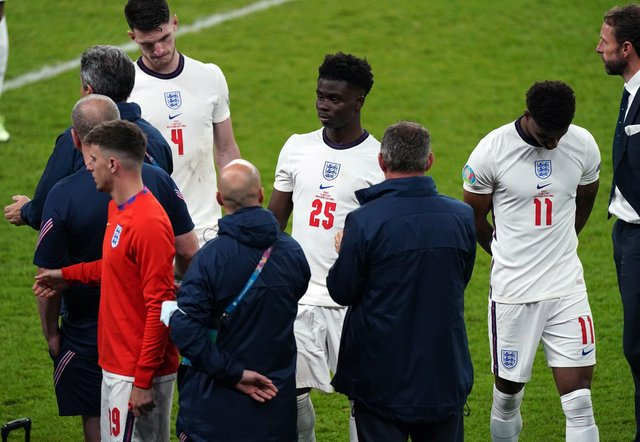 England manager Gareth Southgate stands dejected alongside Bukayo Saka and Marcus Rashford following the UEFA Euro 2020 Final at Wembley Stadium, London. (Picture: PA)