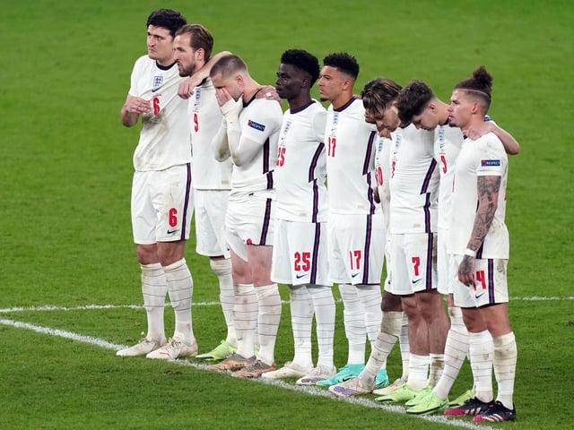 England's Jadon Sancho (17) and Bukayo Saka alongside team mates during the penalty shoot out following the UEFA Euro 2020 Final