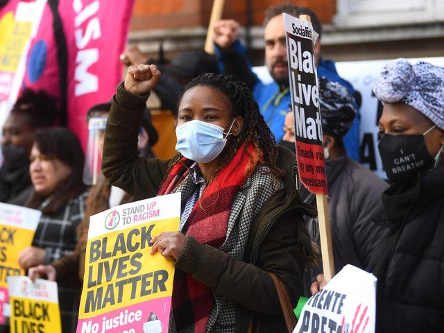 Library image of people taking part in a Take The Knee event in Windrush Square, Brixton, south London, as part of a TUC and Stand Up To Racism week of action.