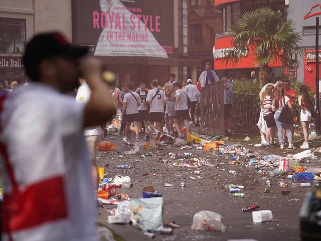 Piles of rubbish left behind by partying England fans in Leicester Square, central London, ahead of the England football team playing in the UEFA Euro 2020 Final. Picture: Andrew Matthews/PA Wire