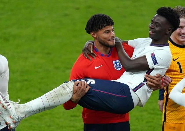 England's Tyrone Mings carries Bukayo Saka as they celebrate winning the UEFA Euro 2020 semi final match at Wembley Stadium, London. (Picture: PA)