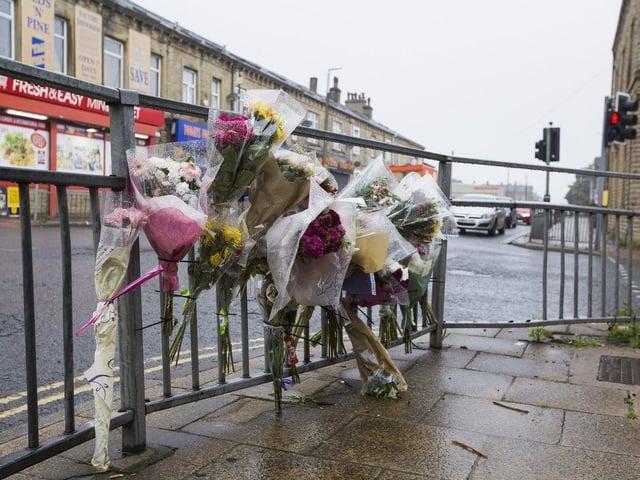 Flowers have been left at the scene in Queen's Road