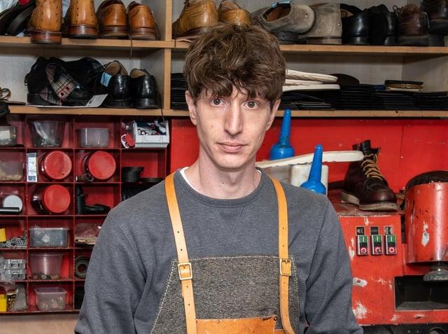 Dean in his shop in Shipley Market Square.