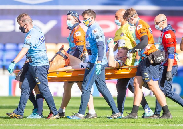 Leeds's Harry Newman is stretchered off after a leg injury against Hull KR last year. Picture: Allan McKenzie/SWpix.com