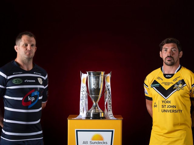 Featherstone Rovers captain James Lockwood, left, and York City Knights counterpart Chris Clarkson with the 1895 Cup. (ALLAN MCKENZIE/SWPIX)