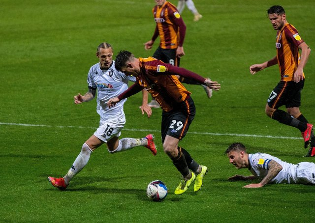 FAMILIAR FACE: Oscar Threlkeld closes in on Bradford City's Andy Cook during Salford's visit to Valley Parade last season.  Picture: Bruce Rollinson