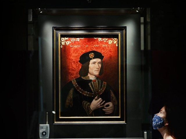 Lucy Creighton, curator of archaeology at the Yorkshire Museum, with the famous late 16th century portrait of Richard III on display at the museum. (Jonathan Gawthorpe).