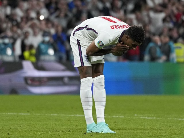 England's Marcus Rashford reacts after he missed during the penalty shootout of the Euro 2020 soccer championship final between England and Italy at Wembley stadium in London, Sunday, July 11, 2021. (AP Photo/Frank Augstein, Pool).