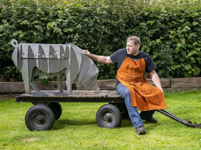 Metal artist Michael Bennett and his pig which can be used as a barbeque, fire pit - or planter Pic: Tony Johnson
