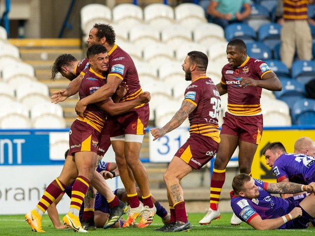 Huddersfield Giants' Will Pryce celebrates his try. (BRUCE ROLLINSON)