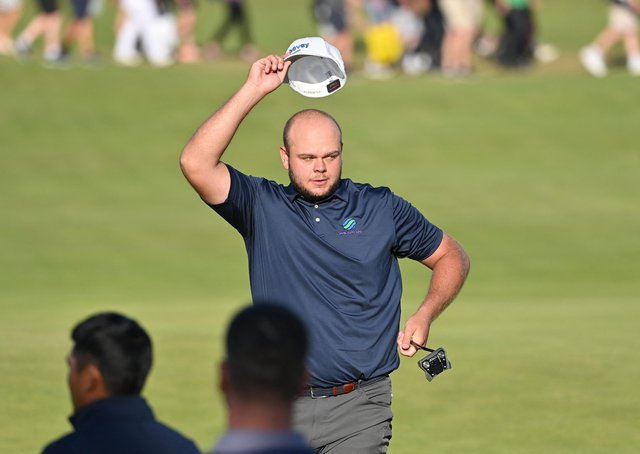 Jonathan Thomson: Accepts the 'roar' of the crowd after acing the par-three 16th hole. (Picture: Getty)