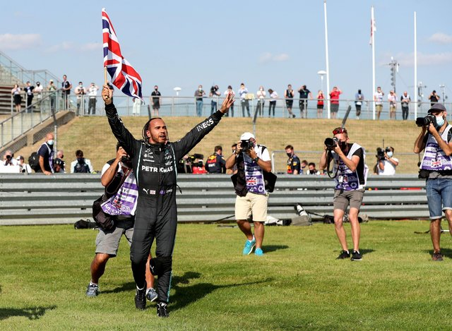 Mercedes' Lewis Hamilton celebrates after winning the British Grand Prix at Silverstone. Picture: Bradley Collyer/PA