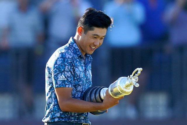 MEMORABLE MOMENT: Collin Morikawa celebrates with the Claret Jug Trophy after winning The Open atRoyal St George's. Picture: Gareth Fuller/PA