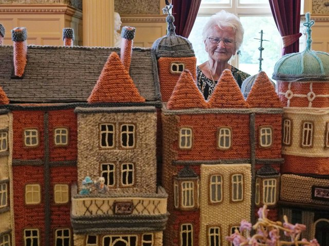 Margaret Seaman from Great Yarmouth, Norfolk, stands next to her creation 'Knitted Sandringham', on display in the Ballroom of Sandringham House