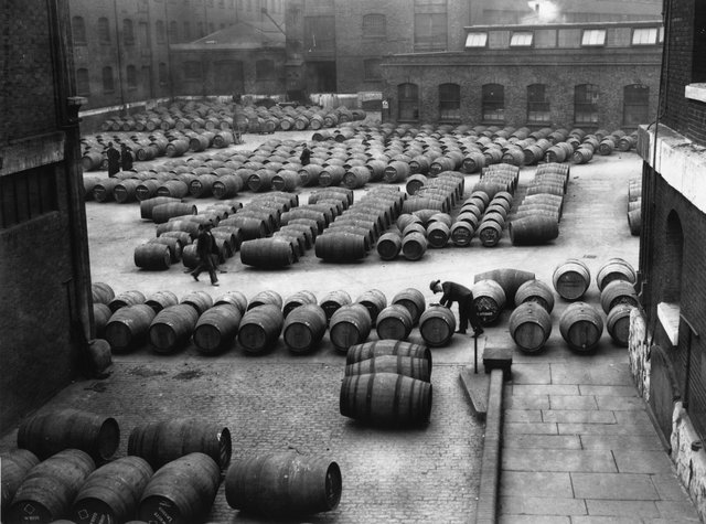 3rd December 1934:  Hundreds of barrels of wine laid out for inspection before being transferred to vaults and warehouses at the Wine Crescent, London Docks.  (Photo by Fox Photos/Getty Images)