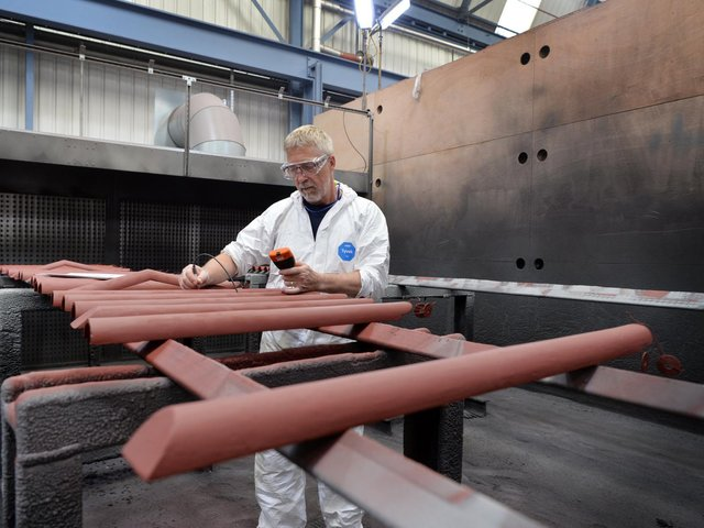 An engineer at Shepley Engineers Limited, Chapeltown, Sheffield, working on restoring parts of roof from the Palace of Westminster.