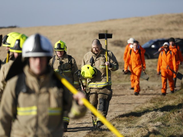 West Yorkshire Fire and Rescue Service firefighters at work. (Pic credit: Thomas Maddick / SWNS)