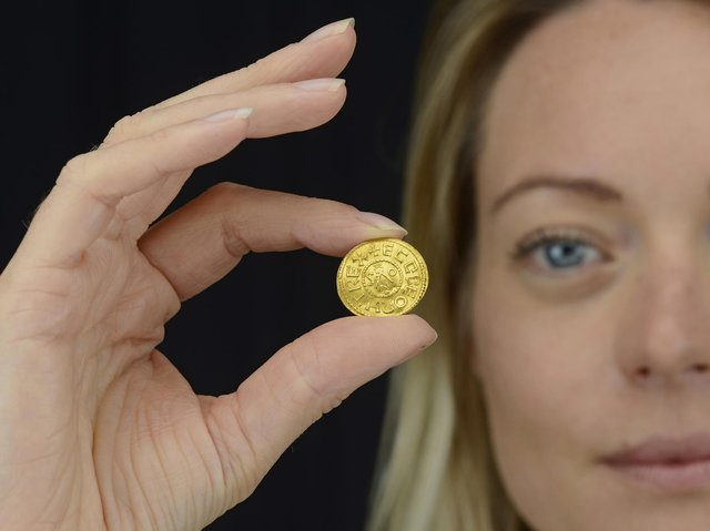 An Anglo-Saxon coin discovered by a metal detectorist which is set to fetch up to £200,000 at auction