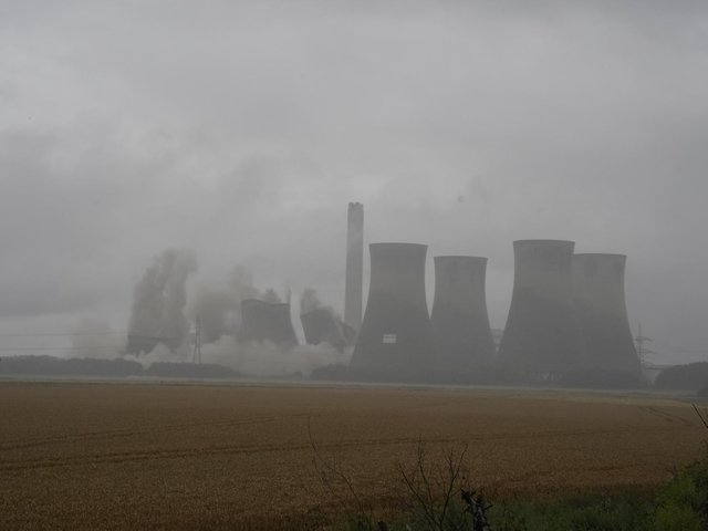 Four of the eight cooling towers at the former coal-fired Eggborough Power Station are demolished