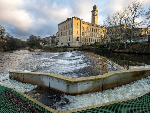 The view of Salts Mill in the UNESCO World Heritage site of Saltaire from Roberts Park across the weir and River Aire. (Picture: Bruce Rollinson)