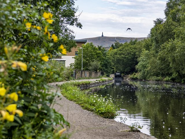 Stoodley Pike seen from the Rochdale Canal in the centre of Todmorden. Picture by Tony Johnson.