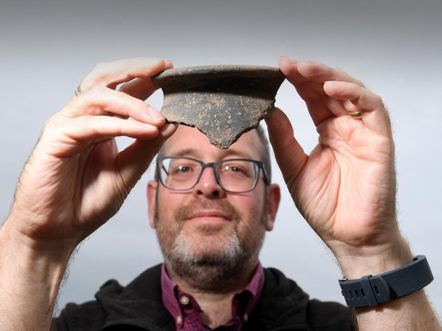 North Yorkshire County Council principal archaeologist Peter Rowe with a fragment of Roman pottery from the dig near Bedale