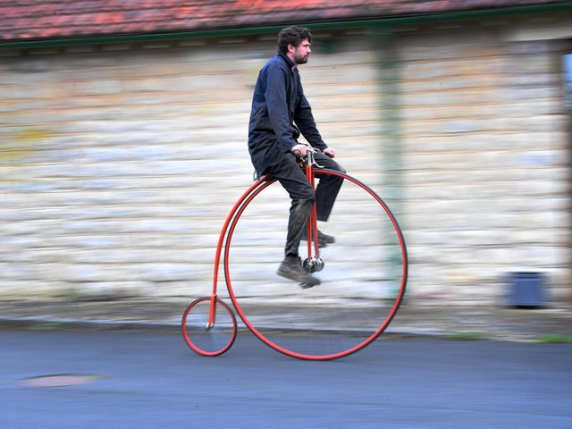 Penny Farthing maker Christian Richards, pictured on one of the cycles he has built, Image: Simon Hulme.
