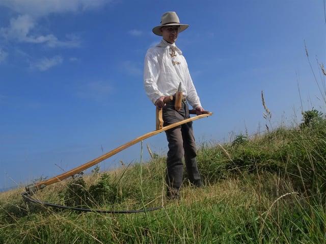 Martin Stevens with his scythe at RSPB Bempton Cliffs