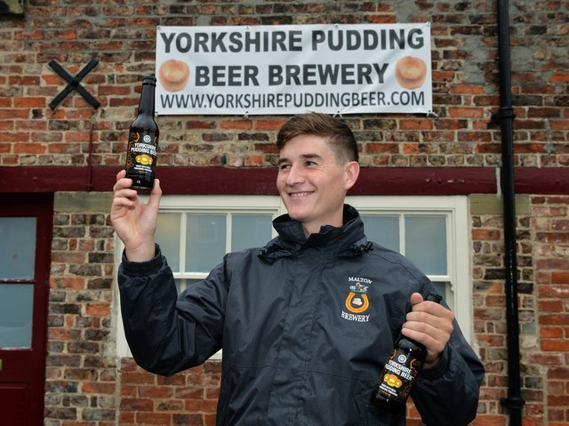Harry Kinder with Yorkshire Pudding Beer at Malton Brewery.