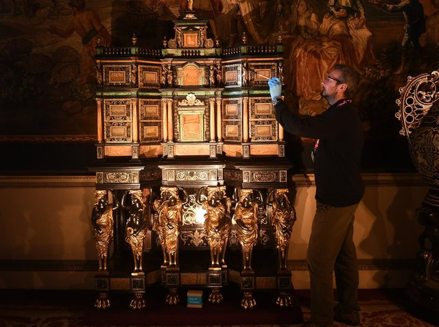 Curator Simon McCormack pictured with a 17th Century Cabinet which be by the hand of Pierre Gole a furntiure maker to Louis XIV