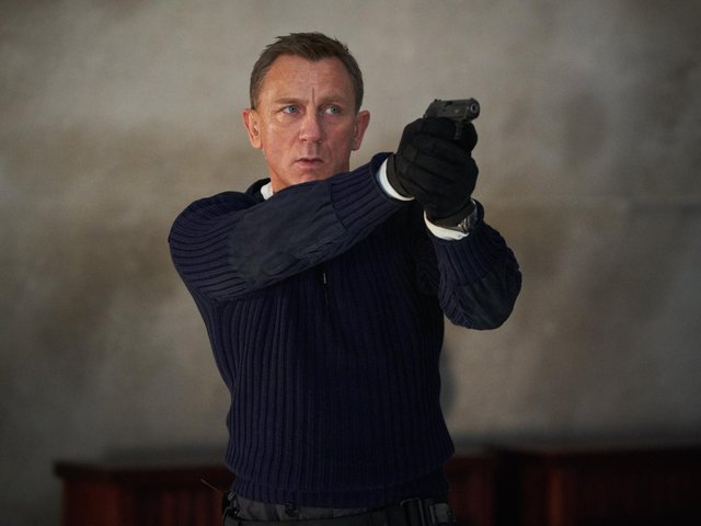 Daniel Craig playing James Bond in the new Bond film No Time To Die. (PA).