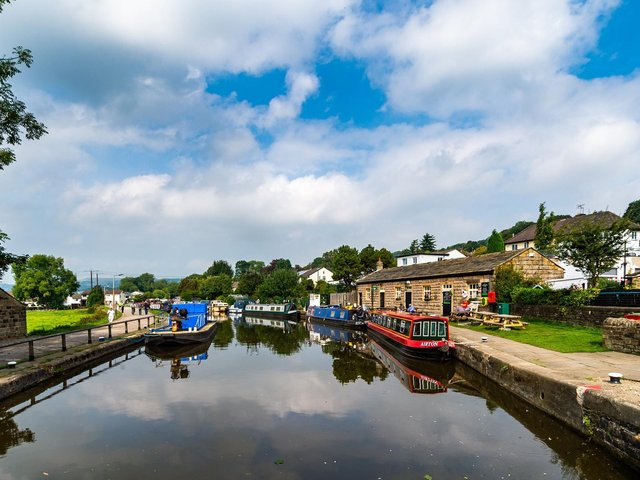 Canal boats on the Leeds Liverpool Canal above the Five-Rise Locks, Bingley. (James Hardisty).