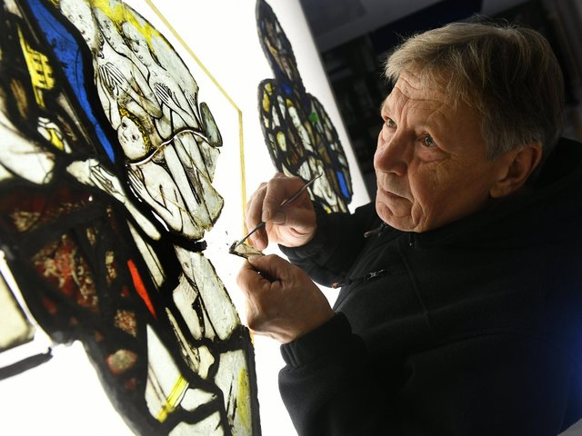 Keith Barley Director and Conservationist at Barley Studio's near York working on the third window from All Saints Church North Street, York, depicting St Peter greeting the good at the gates to heaven. Gary Longbottom