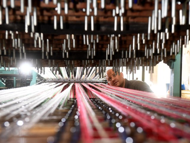 Richard Hughes pictured checking the looms. (Simon Hulme).